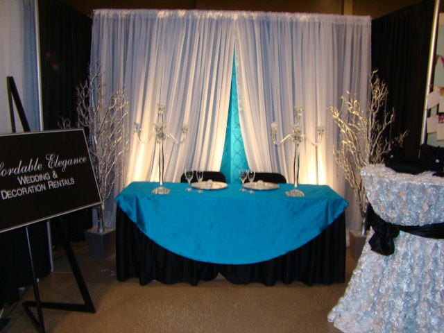 Bermuda Blue Inifinity Drape and White Voile Backdrop